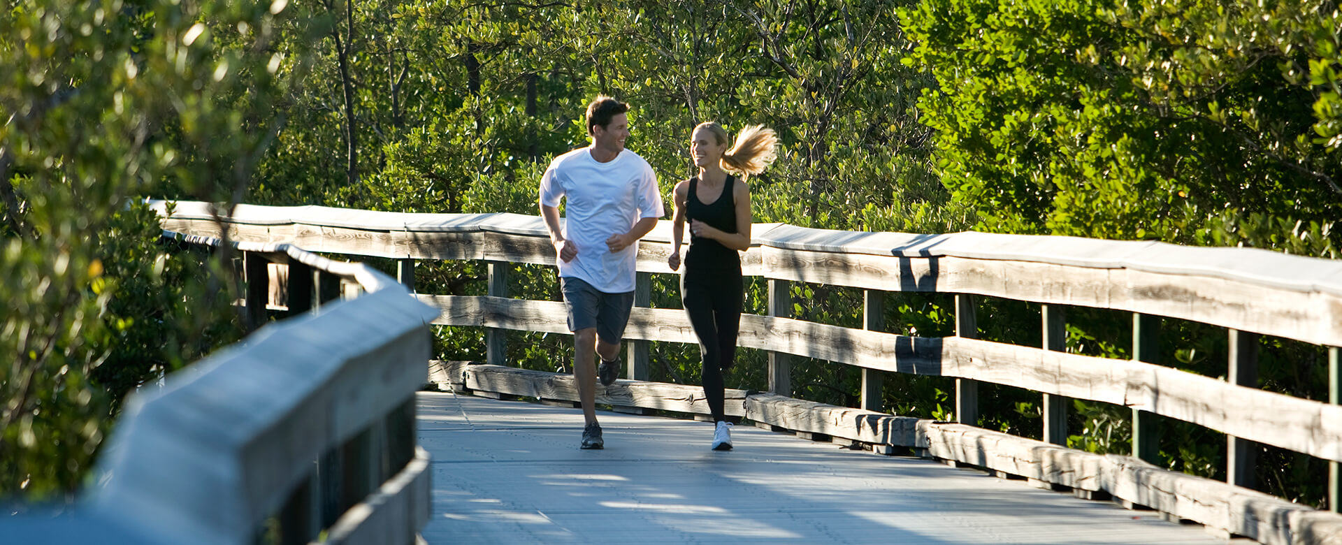 couple jogging on the boardwalk