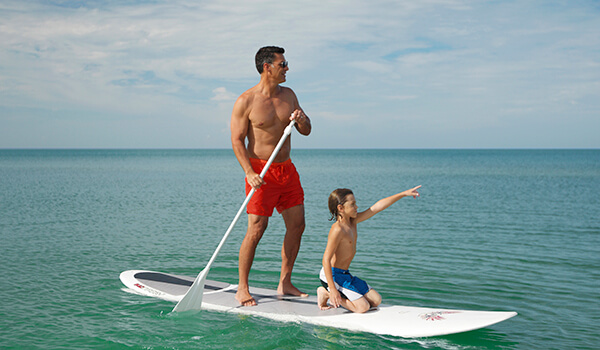 Paddleboard In Naples Florida While You Stay At Grande Beach Resort