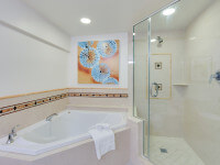 Spacious bathrooms with dual vanities, separate glass enclosed walk-in showers and oversized soaking tubs