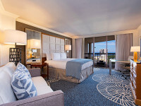 King sized bed and private balcony in our Signature Gulf View guest room