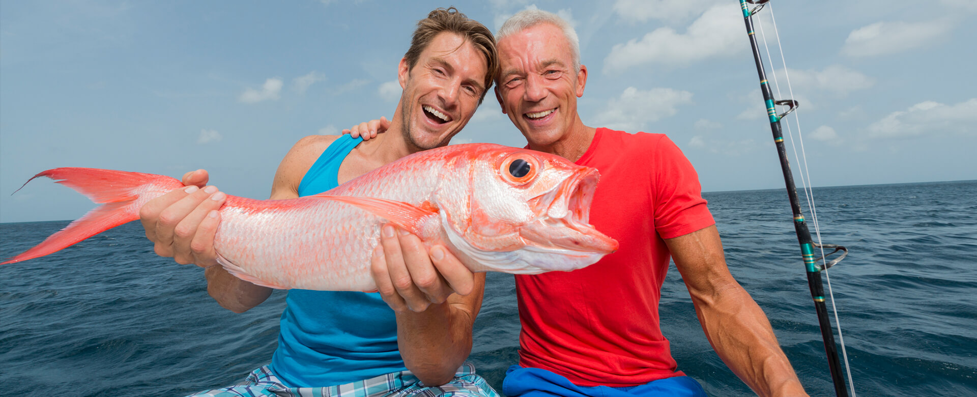 men posing with a fish in naples