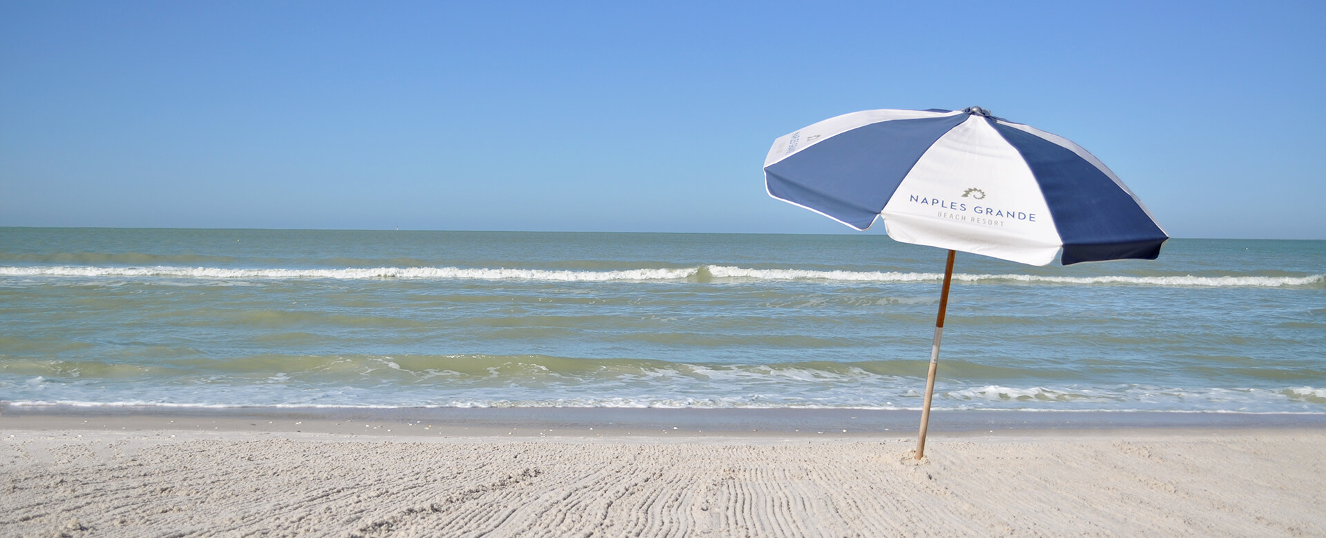 naples grande umbrella on beach